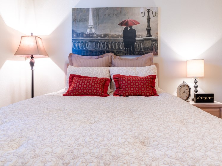 1 Bedroom bed with red pillows