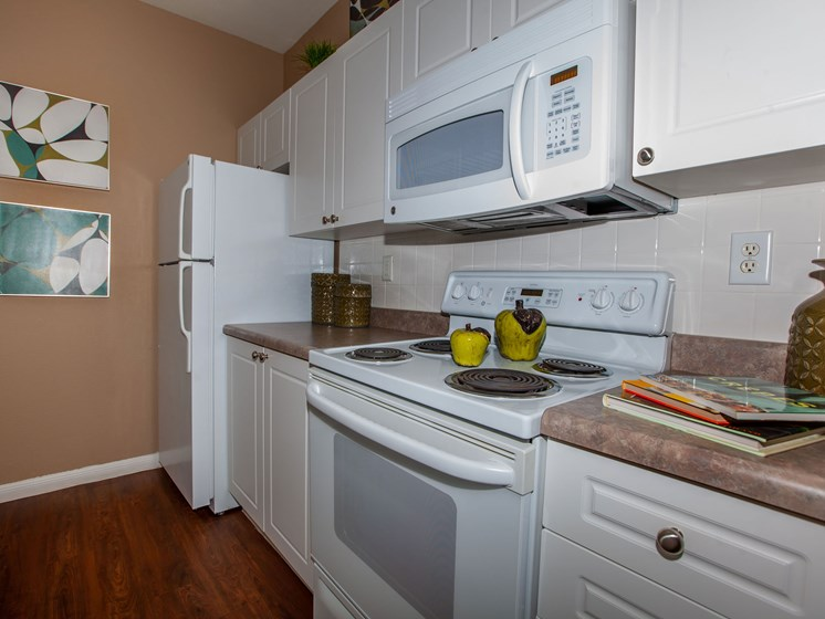 kitchen with oven range microwave and refrigerator