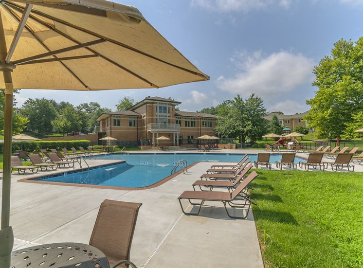 West Chester, PA apartments with large swimming pool and lounge chairs