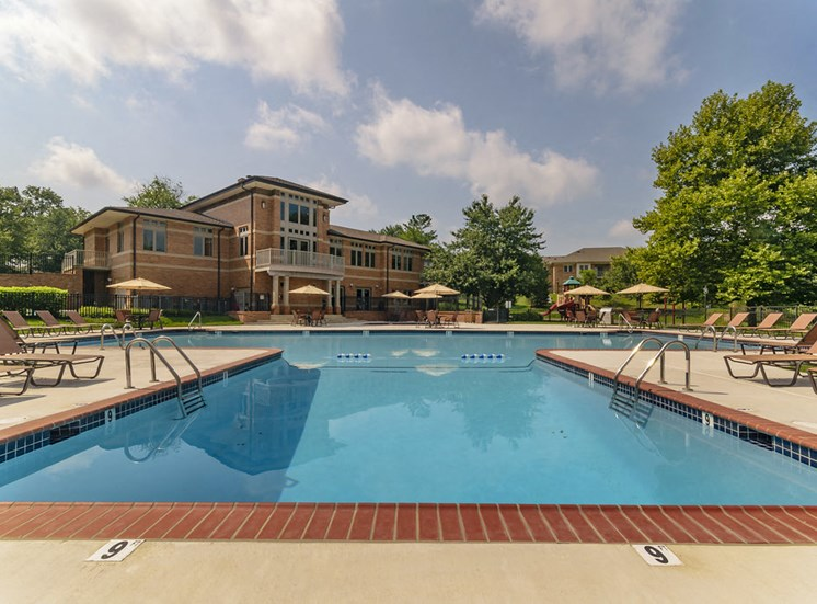 Luxury swimming pool with lounge chairs at West Chester apartments