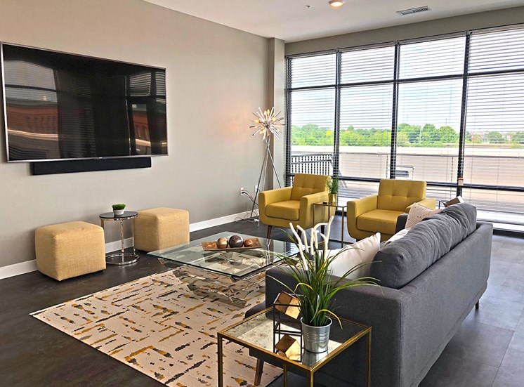 The lounge is equipped with comfortable seating, a television, and space to gather with friends.