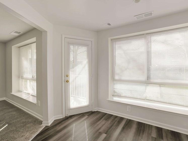 Hardwood floor with door to outside