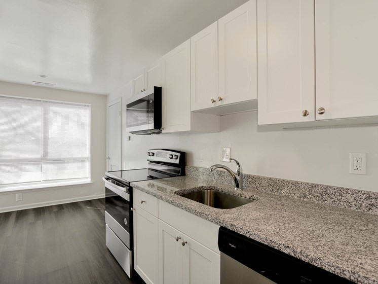 Kitchen with white cabinets and granite countertops