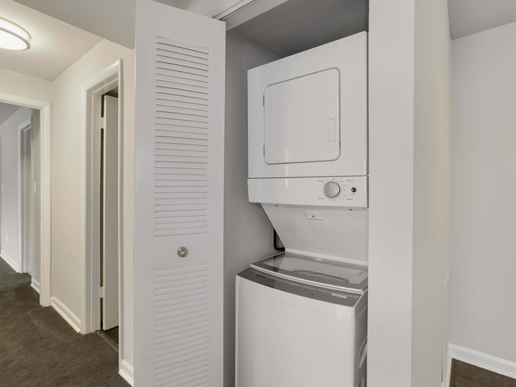 Small closet with washer and dryer