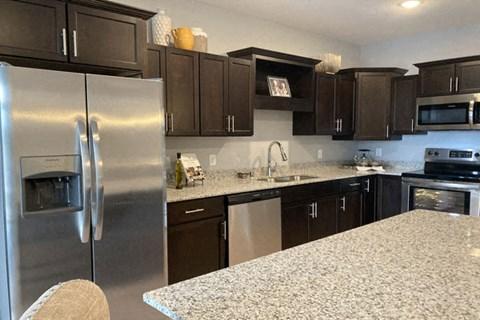 kitchen with dark cabinets