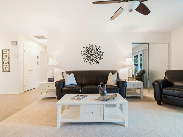 Living Room With Expansive Window at Westmont Village, Riverside