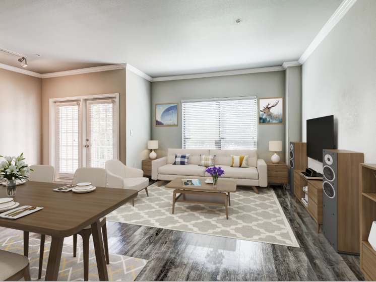 Living room with large windows, wood-style flooring, entry to private patio/balcony