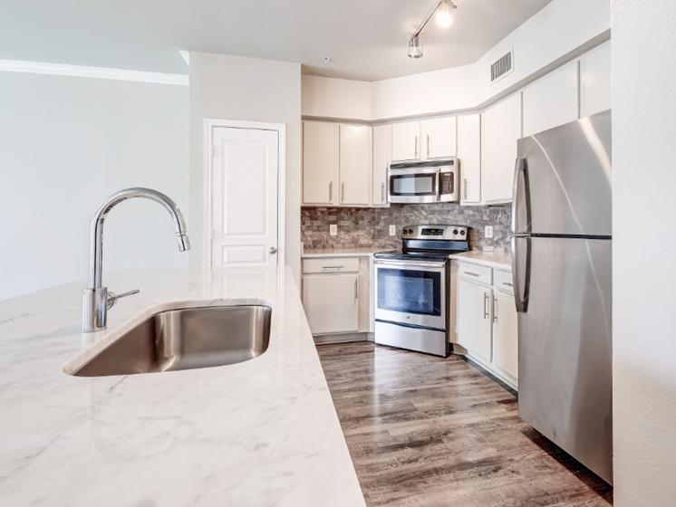 Marble countertops and deep garden kitchen sink