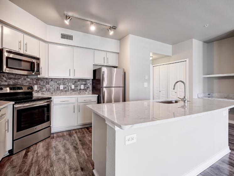 Kitchen with stainless steel appliances and built-in work desk
