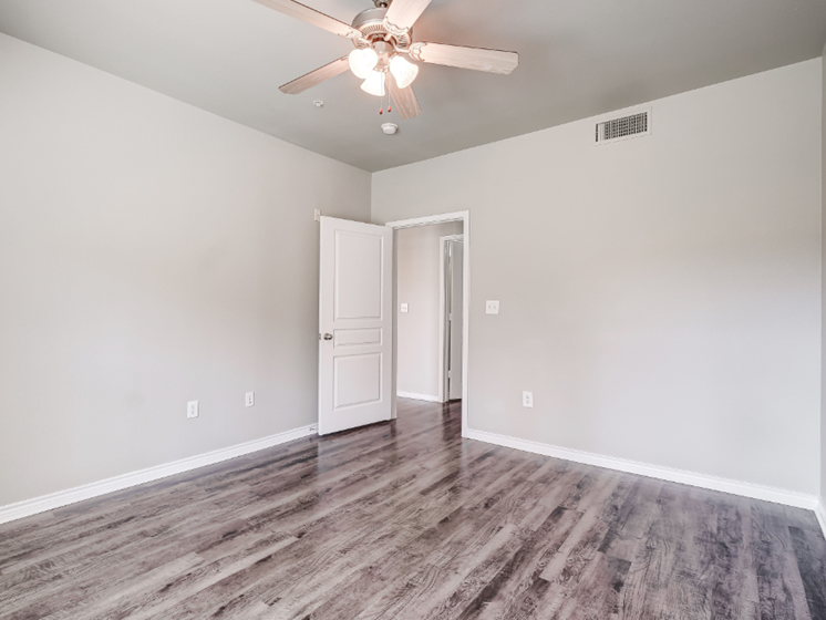 Bedroom with wood-style flooring, ceiling fan, and cable ready