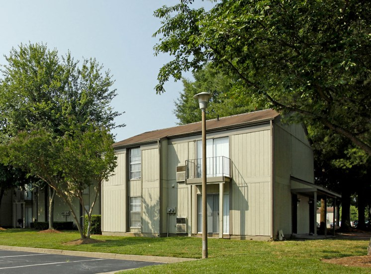apartment exterior with established landscaping