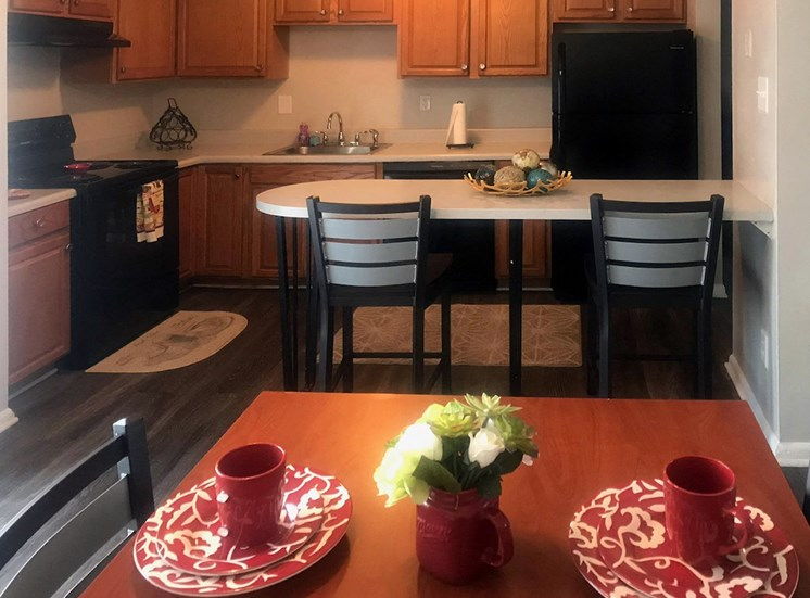 furnished kitchen with table and chairs at River Road Terrace