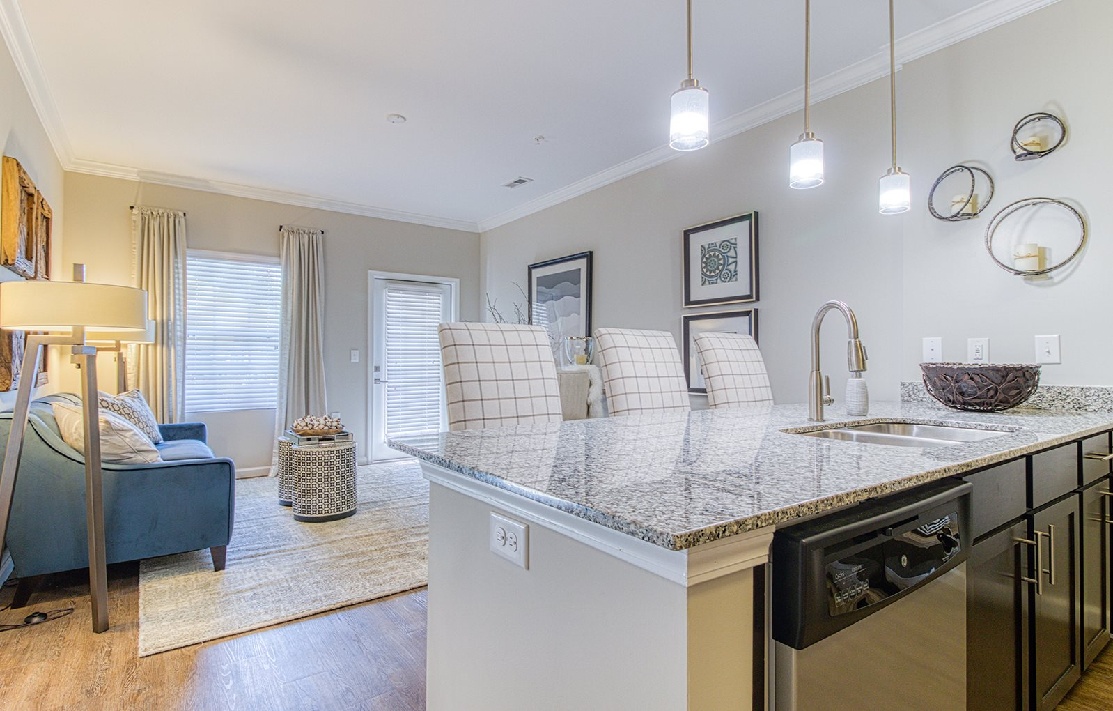 open concept kitchen space with granite countertops