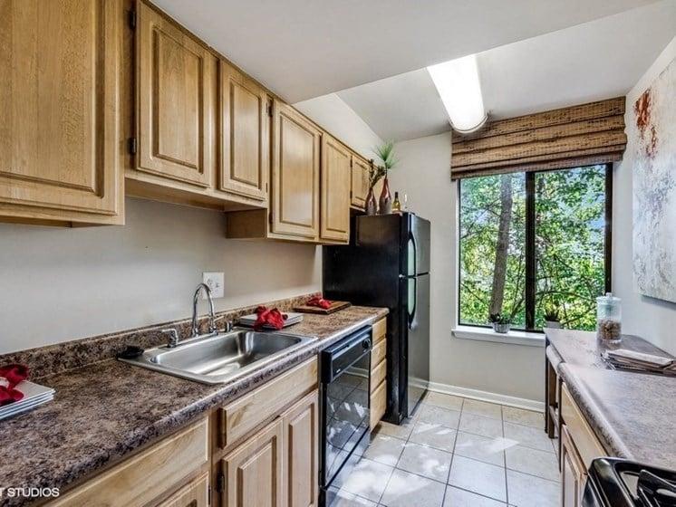 Updated Kitchen With Black Appliances at Brookland Ridge Apartments, Washington