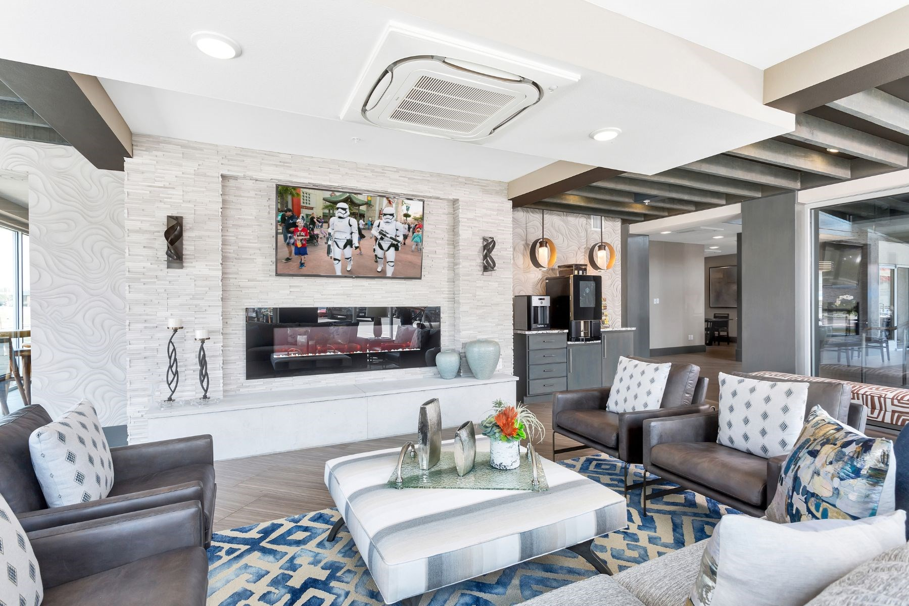 Westwood Green Apartments Clubhouse Lounge with couches, fireplace and tv