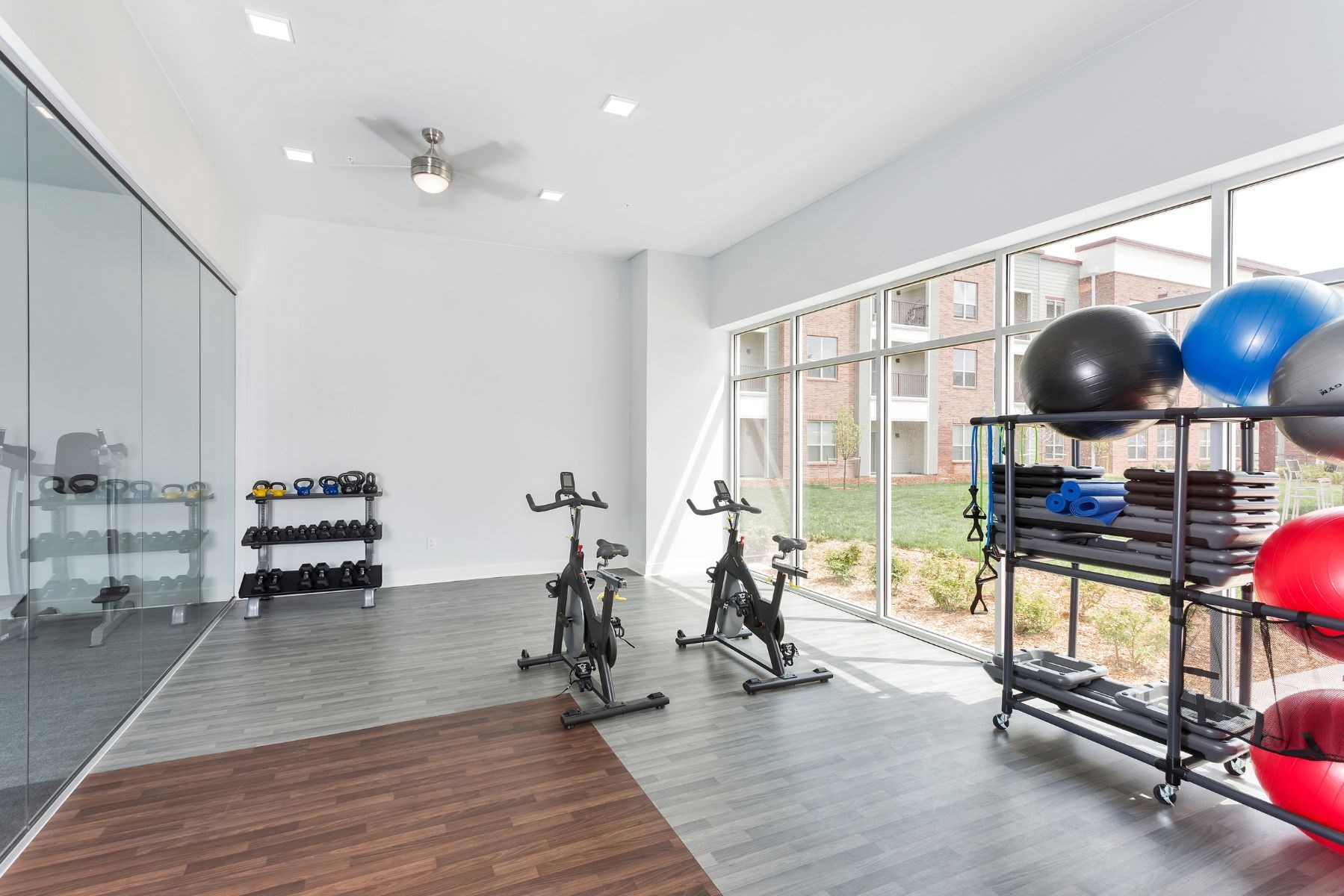 Westwood Green Apartments Wellness Room with spin bikes, and free weights
