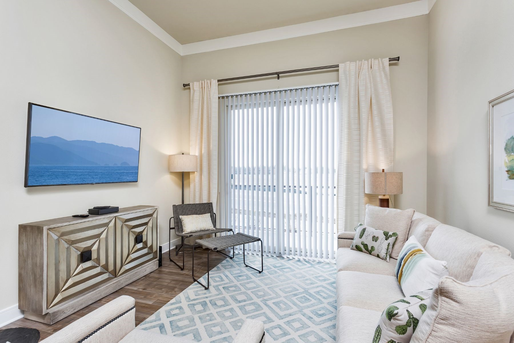 Westwood Green Apartments Living Room with faux wood floors and sliding doors to balcony