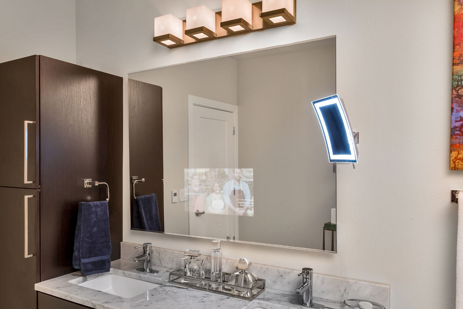 Westwood Green Apartments Bathroom Vanity with tv built into mirror