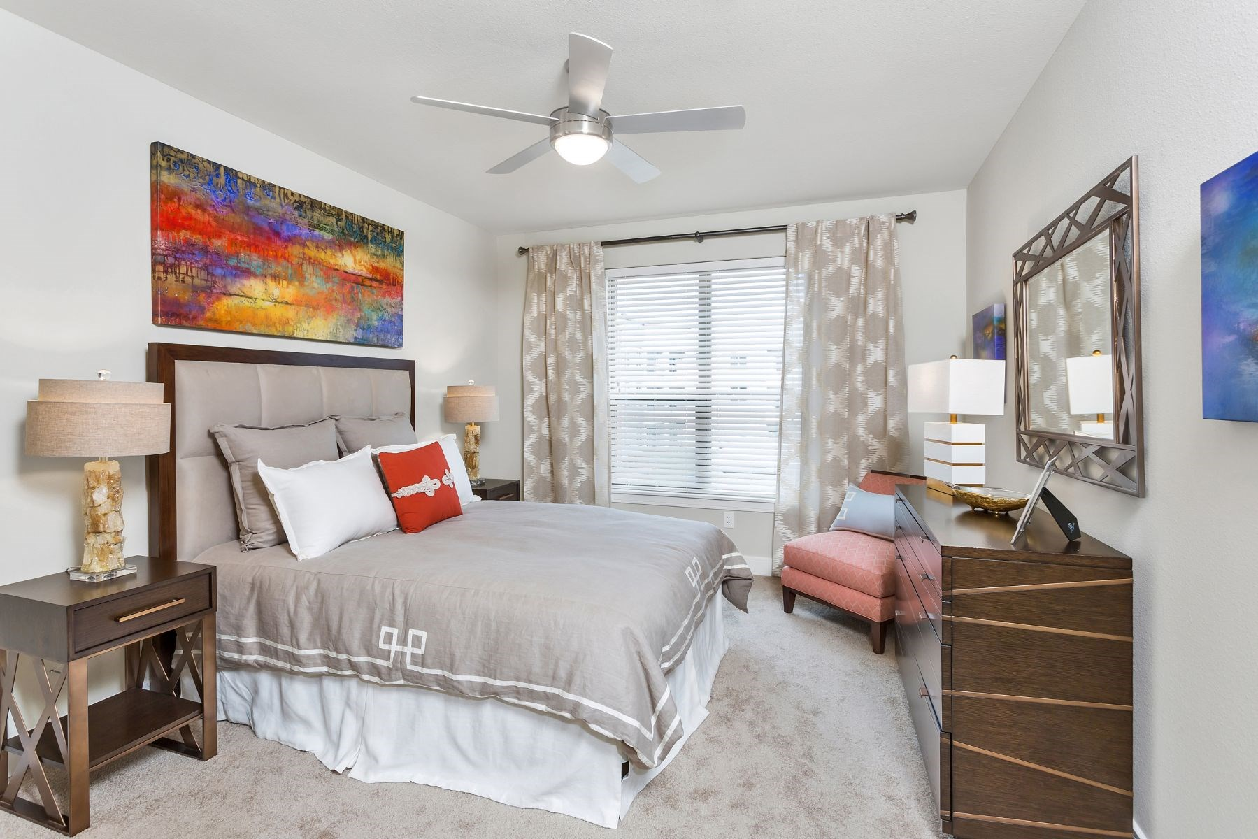 Westwood Green Apartments Bedroom with wall to wall carpet, ceiling fan, and large window