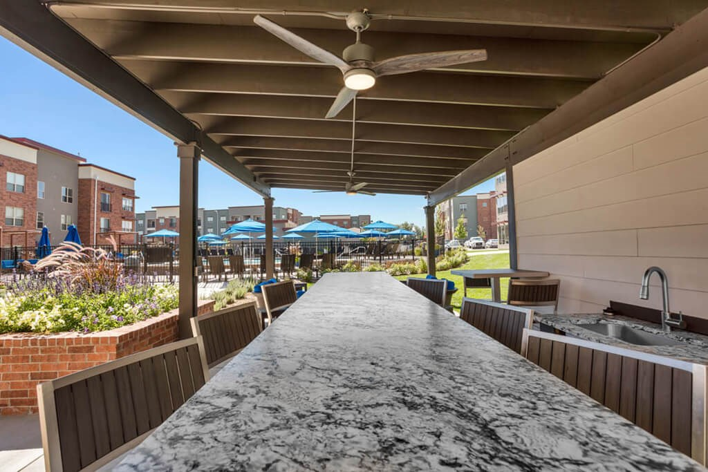 Westlake Greens Outdoor Kitchen grey granite countertop with sink and outdoor ceiling fan
