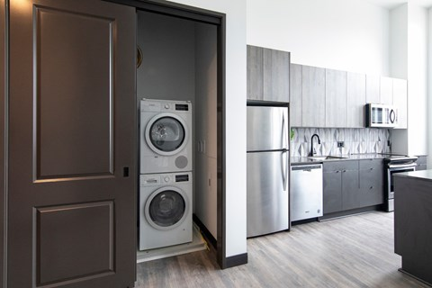 Fully Equipped Kitchen Includes Frost-Free Refrigerator, Electric Range, & Dishwasher at The May, Ohio