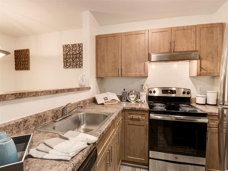 Stainless Steel Appliances including Electric Range, Refrigerator, Dishwasher, and Microwave