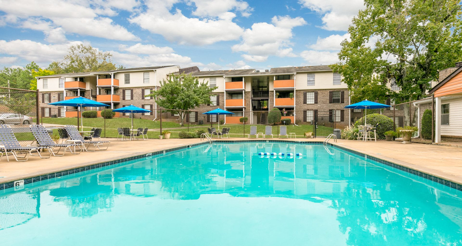 Sparkling Pool and Sundeck at Crestwood Green at 701 Apartments