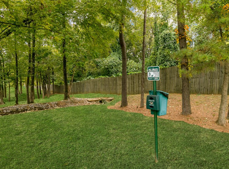 large green space with pet waste stations