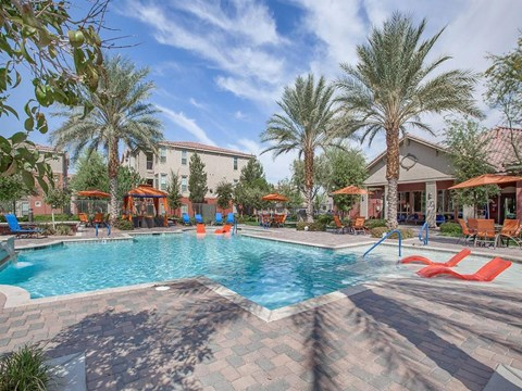 Sonata Pool Surrounded By Relaxing Area in North Las Vegas Apartment Homes