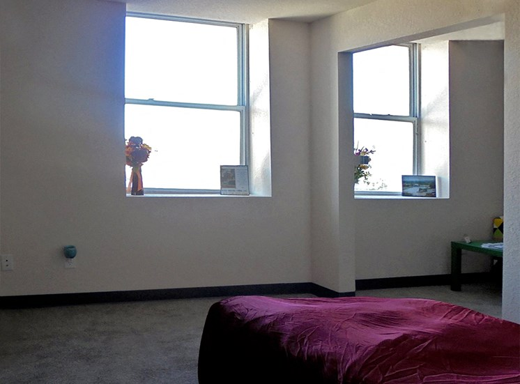 Bedroom with natural lighting at Hoffman Hotel Apartments