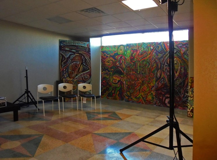 mural in room with studio lighting and chairs for seating