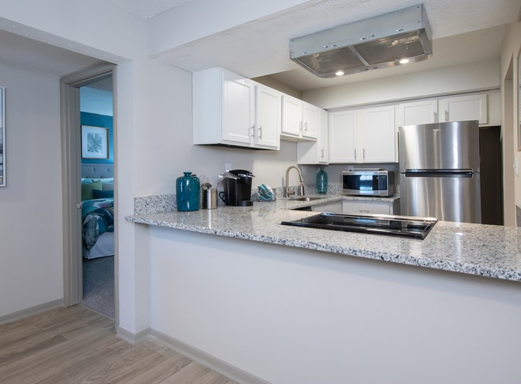 Renovated kitchen with granite countertops and stainless steel appliances