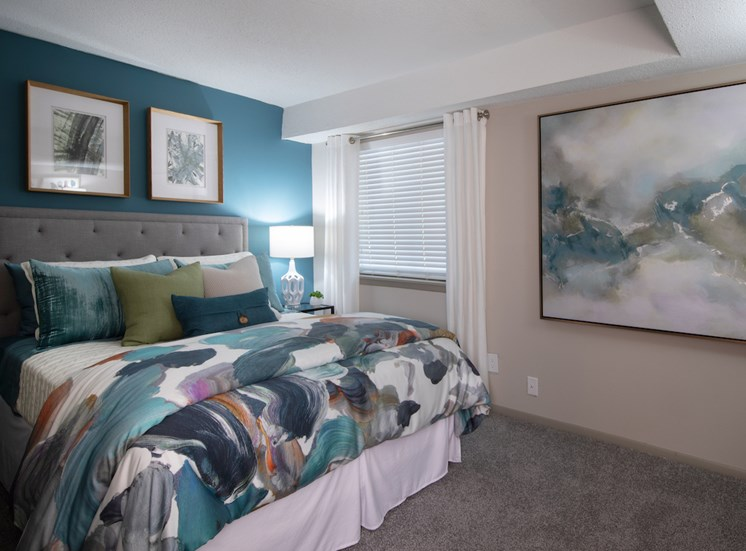 Bedroom with accent wall and model furnishings