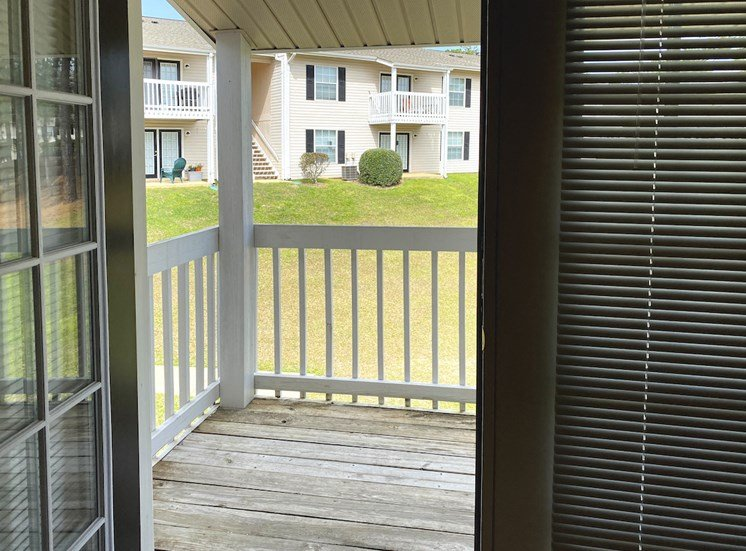 double doors leading to private deck overlooking community