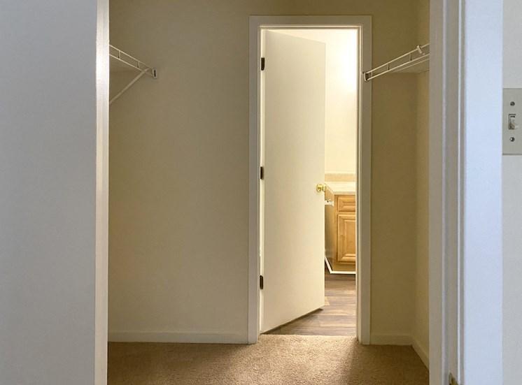 closet area with doorway to bathroom