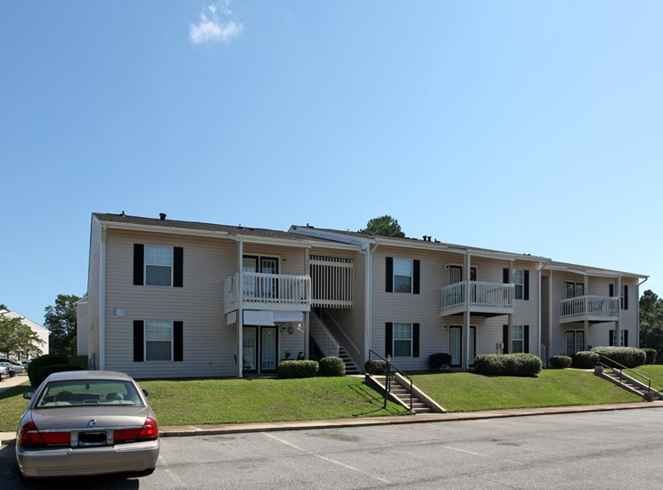 autumn chase apartment building with ample parking out front