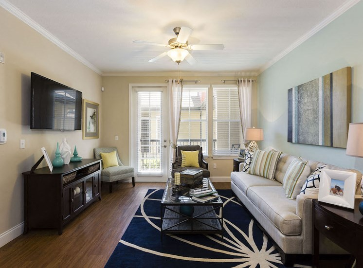 furnished living room with high ceiling and ceiling fan