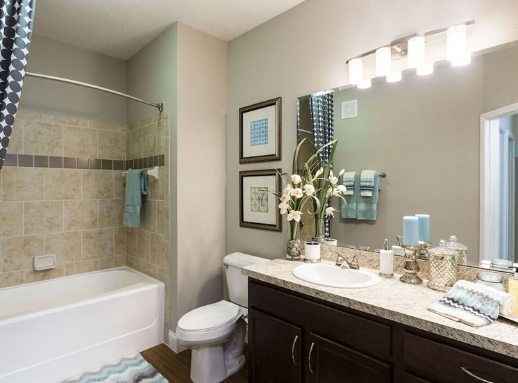 spacious bathroom with large vanity and bright lighting