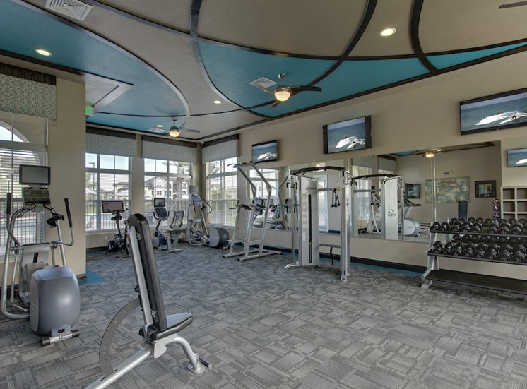 free weights, benches, and other fitness equipment in fitness center