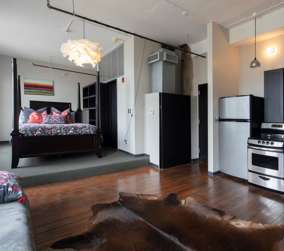 Modern loft with stainless steel, platform area for bedroom and hardwood floors