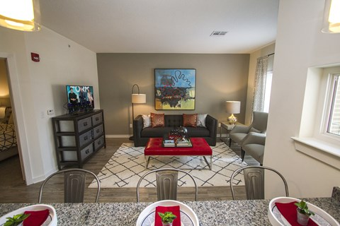 Overlooking the granite coutnertop bar into the living room with hardwood floors.
