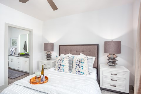 Large bedroom with ceiling fan and attached bathroom