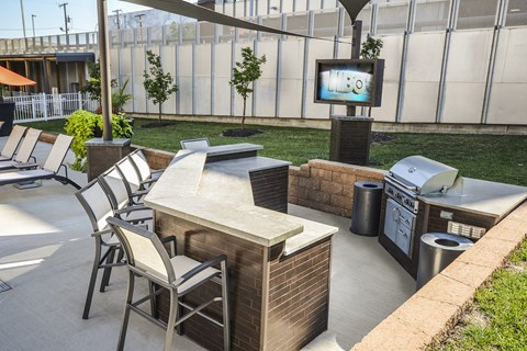 Outside grilling station with five seats, outside tv and gas grill