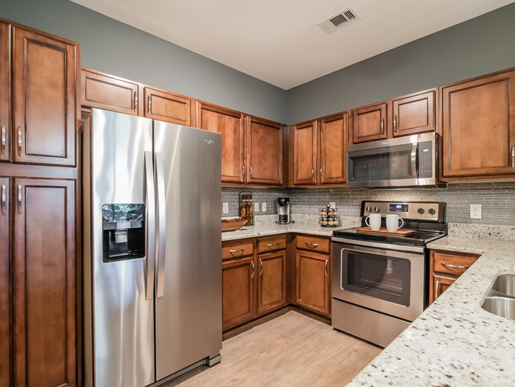 Fully Equipped Kitchen Includes Frost-Free Refrigerator, Electric Range, & Dishwasher at Sorelle, Georgia, 30324