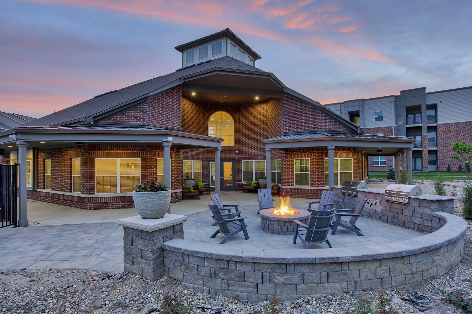 Clubhouse exterior with fire pits at The Apex at Twin Creek Apartments in Bellevue, NE