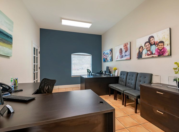 Leasing office with tile flooring, chairs, and desks