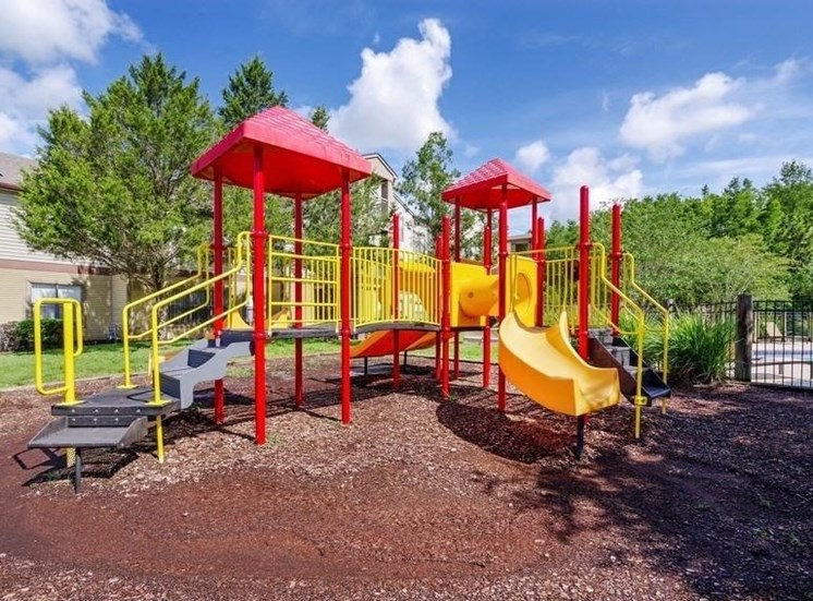 Red and Yellow Playground on Mulch
