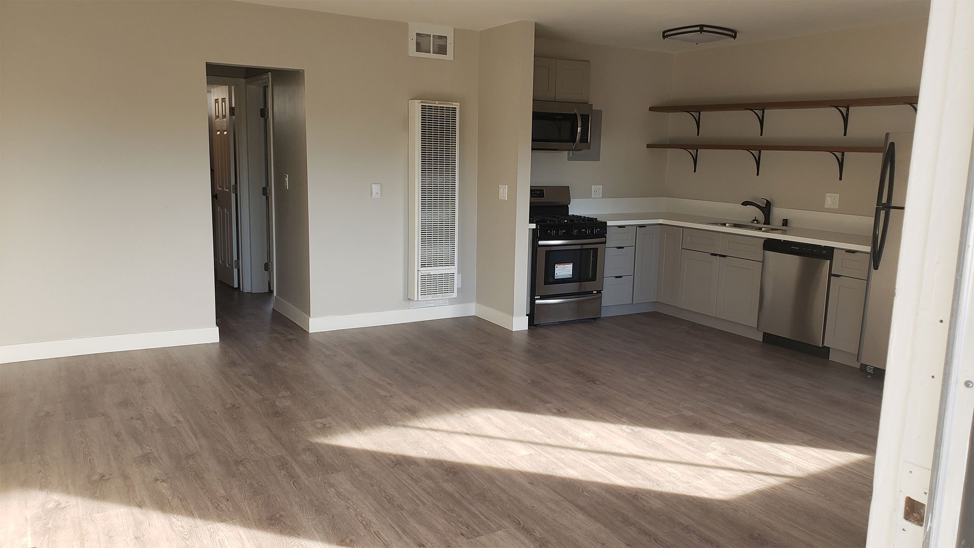 Living Room Space Near Kitchen and Dining Are at Wilson Apartments in Glendale, CA