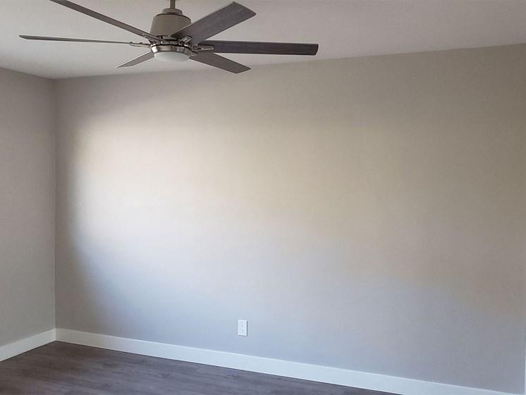 Bedroom with Window, Ceiling Fan, Hardwood Flooring at Wilson Apartments in Glendale, CA