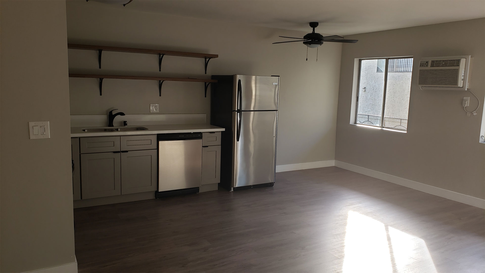 Kitchen Area With Ceiling Fan, Hardwood Flooring, Stainless Steel Appliances at Wilson Apartments in Glendale, CA